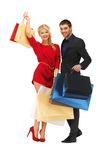 Man and woman with shopping bags Royalty Free Stock Image