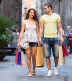 Man and woman with shopping bags Royalty Free Stock Photos