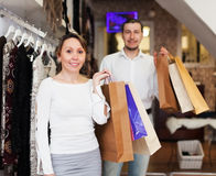 Man and woman with shopping bags at shop. Man and women with shopping bags at clothing shop Stock Photo