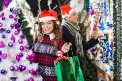 Man And Woman Shopping In Christmas Store Royalty Free Stock Images