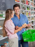 Man With Woman Shopping In Grocery Store Stock Images