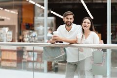 Man and woman in shopping mall. Couple is relaxing, happy after shopping. royalty free stock image