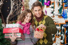 Man With Woman Shopping Presents In Christmas Stock Images