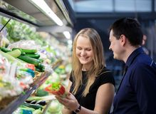 Man and woman shopping for vegetables Royalty Free Stock Photography