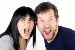 Man and woman shouting like crazy looking isolated Royalty Free Stock Photo
