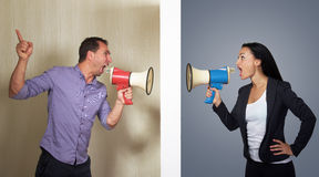 Man and woman shouting stock images