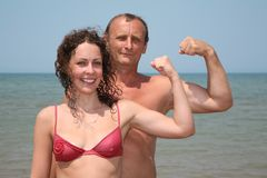 Man and woman show bicepses Stock Photo