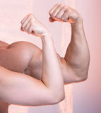 Man and a woman show their biceps. (only arms and body stock image