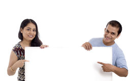 Man and Woman showing blank signboard or Banner Stock Photo