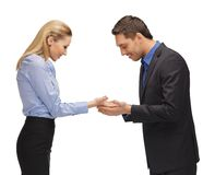 Man and woman showing something on the palms Stock Image