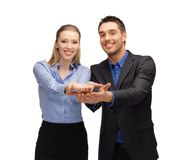 Man and woman showing something on the palms Stock Photos