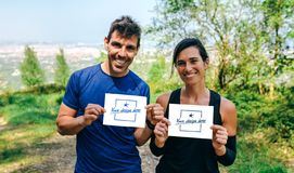 Man and woman showing their trail race number royalty free stock image