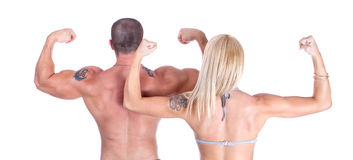 Man and woman showing who's back is bigge Stock Photography