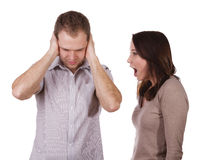 The man and the woman. Man shutting his ears and not listening to the persistent yelling of his spouse Royalty Free Stock Photography