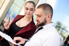 man and woman sign a marriage contract Stock Image