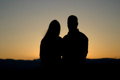 Man and Woman Silhouette 2. Wonderful silhouette of a male and female couple at sunset Royalty Free Stock Photography