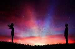 Man and woman silhouette standing opposite colorful surreal sunset sky royalty free illustration