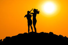 Man and woman silhouette at sunset Royalty Free Stock Photos