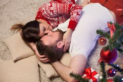 A man and a woman sit at the Christmas tree new year gifts holiday winter royalty free stock photos