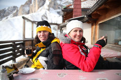Man and woman sit in mountain cafe Royalty Free Stock Image