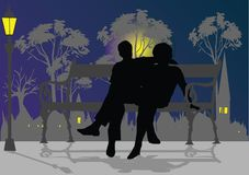 Man and woman siting. On the bench Royalty Free Stock Photography