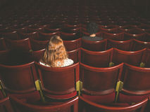 Man and woman sitting in auditorium Royalty Free Stock Image