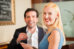 Man and a woman sitting in cafe Stock Images