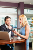 A man and a woman - sitting in cafe Stock Images
