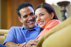 Man and woman sitting on couch. Royalty Free Stock Image