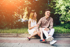 Man and woman sitting on the curb Royalty Free Stock Images