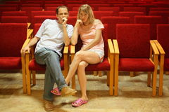 Man and woman sitting in empty presentation hall. royalty free stock photography