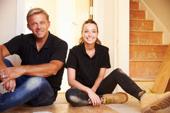 Man and woman sitting on floor during house refurbishment Royalty Free Stock Photography
