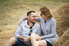 Man and Woman Sitting on Hay Royalty Free Stock Photos