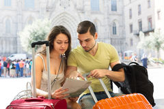 Man and woman sitting near the baggage Stock Image