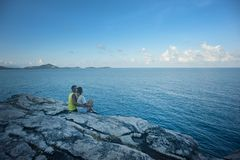 Man and Woman Sitting Near Body of Water Stock Photos
