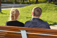 Man and woman sitting in park Royalty Free Stock Images