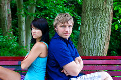 Man and woman sitting on the park bench Stock Photo