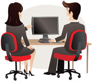 Man and woman sitting at PC Stock Photography