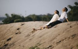 Man and Woman Sitting on the Sand royalty free stock photos