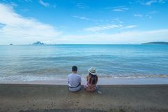 Man and Woman Sitting on Seashore stock image