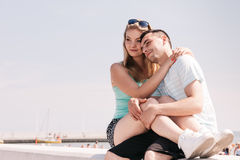 Man and woman sitting together outside Stock Images