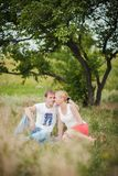Man woman sitting under tree Stock Images
