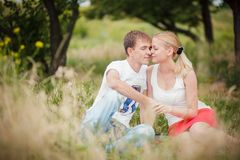 Man woman sitting under tree Stock Photos