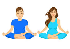 Man and woman sitting in yoga pose Stock Image