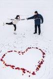 Man and woman on skates Royalty Free Stock Image