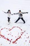 Man and woman on skates Stock Photos