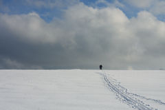 Man and woman on ski track against cloudy sky Royalty Free Stock Photos