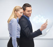 Man and woman with smartphone Royalty Free Stock Photography