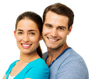 Man And Woman Smiling Against White Background Royalty Free Stock Images