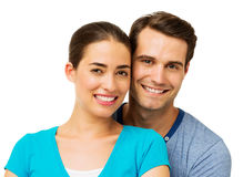 Man And Woman Smiling Against White Background Royalty Free Stock Image